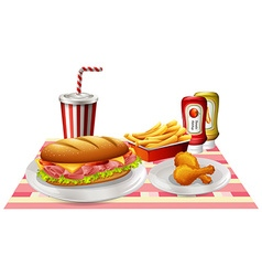 Sandwiches and fried chicken on the table vector