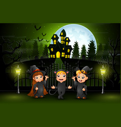 Happy halloween kids outdoors with haunted house b vector