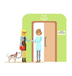 woman holding a dog on a leash in veterinary vector image