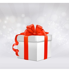 red gift box with red ribbons vector image