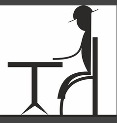 Man sitting at table icon vector