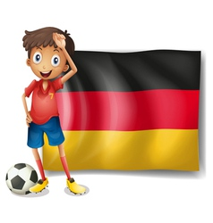 A football player in front of the flag of Germany vector image vector image