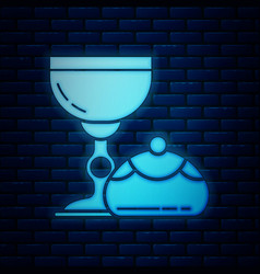 Glowing neon jewish goblet and hanukkah sufganiyot vector