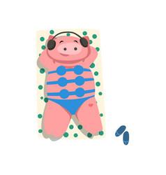 pig with headphones and bikini sunbathing on the vector image