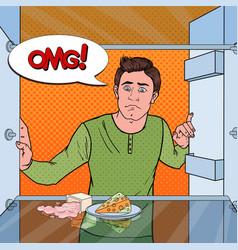 Pop art unhappy hungry man looking in empty fridge vector