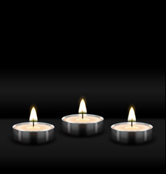 three tealight burning realistic candles on black vector image