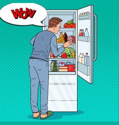 Pop art man looking inside fridge full of food vector