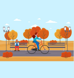 young woman riding on bicycle in a park vector image