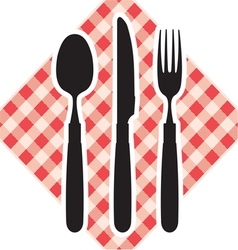 Cutlery on tablecloth vector