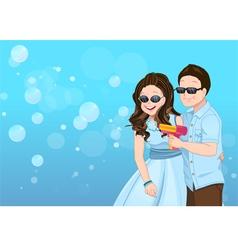 Playful couple cartoon with soap bubble guns vector image