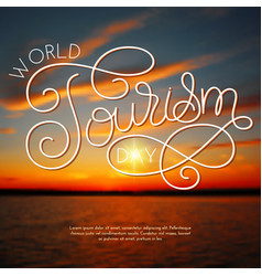 World tourism day hand lettering on blurred photo vector