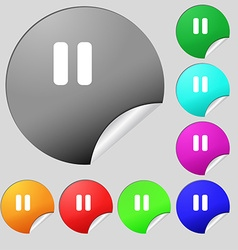pause icon sign Set of eight multi-colored round vector image