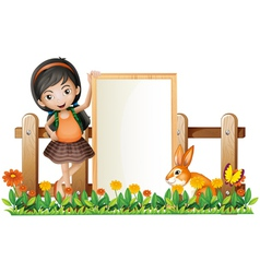 A girl standing beside an empty frame with a bunny vector