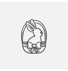 Easter bunny sitting in basket sketch icon vector image