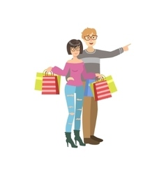 Couple With Paper Bags In Shopping Mall vector
