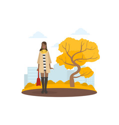 young woman in fashion clothing walking in autumn vector image