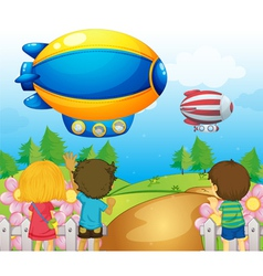 Kids watching the airships vector image