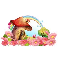 A mushroom house with a garden of flowers vector
