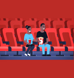 Couple watching movie sitting in cinema vector