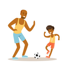 Smiling man and boy playing soccer dad and son vector