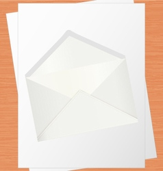 Blank White Paper And Envelope On Oak Table vector image vector image