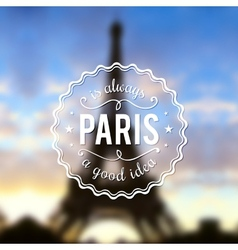 Paris typographic design on blurred Eiffel tower vector