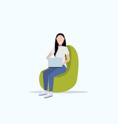 Woman sitting in bean bag armchair smiling girl vector