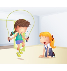 A girl playing jumping rope inside the room vector image vector image