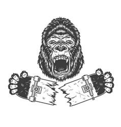 angry gorilla holding broken skateboard vector image