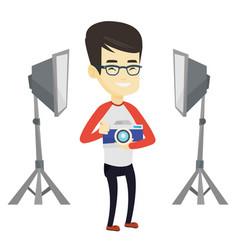 Photographer with camera in photo studio vector