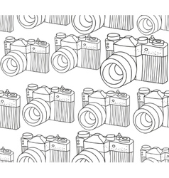 Seamless pattern with retro photo camera vector image