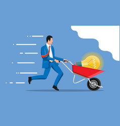 Businessman pushing wheelbarrow with idea bulb vector