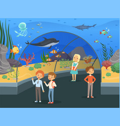 Kids in aquarium family walk threw underwater vector