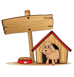A cute dog at his dog house vector