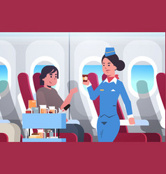 flight attendant serving drinks to passenger vector image