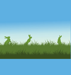 Silhouette of rabbit on field scenery vector