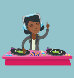 Young african dj mixing music on turntables vector