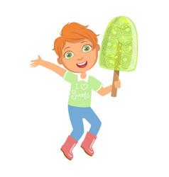 smiling boy holding a big green fruit ice cream a vector image vector image