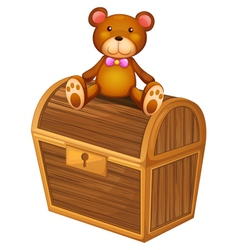 A bear at the top of a treasure chest vector image