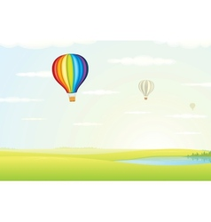 Hot Air Balloon over Green Fields Image vector image vector image