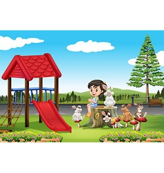 Girl and rabbits in the playground vector image vector image