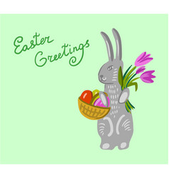easter bunny holding a basket with big paschal vector image