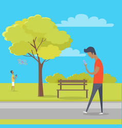 Boy with smartphone on walk in park out town vector