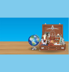 globe travel landmark in suitcase with airplane vector image