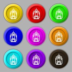 skyscraper icon sign symbol on nine round vector image