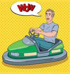 Pop art excited man riding bumber car at fun fair vector
