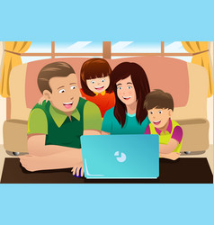 happy family looking at a laptop vector image