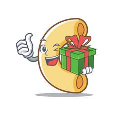 With gift macaroni mascot cartoon style vector