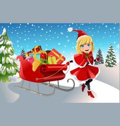 christmas girl pulling sleigh vector image
