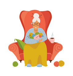 Knitting old female sitting in a cozy armchair vector